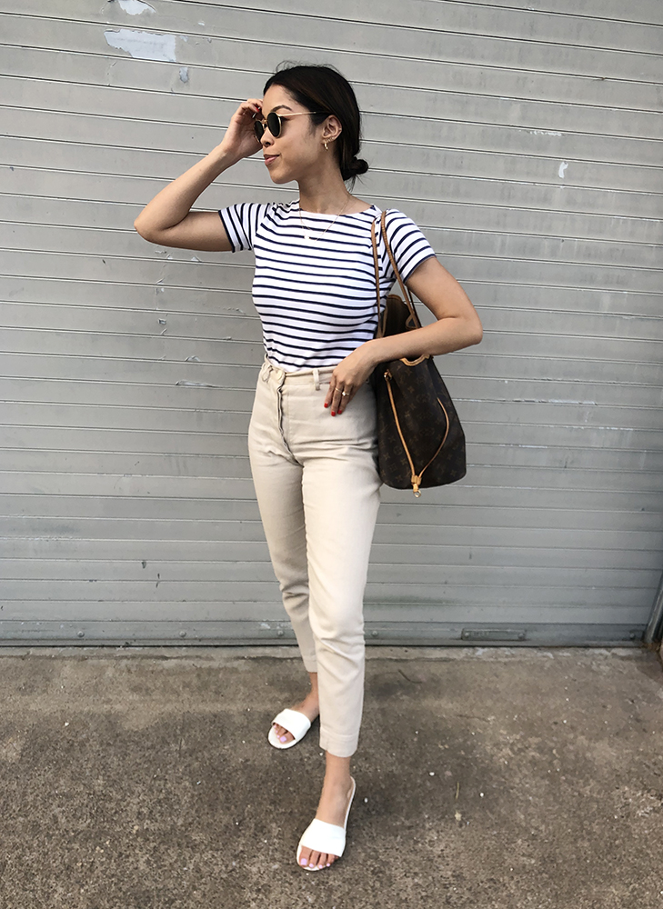 Tiana: Vintage Striped Tee. Jesse Kamm Pants. Marais Shoes. Ray-Ban Sunglasses. Louis Vuitton Neverfull Tote.