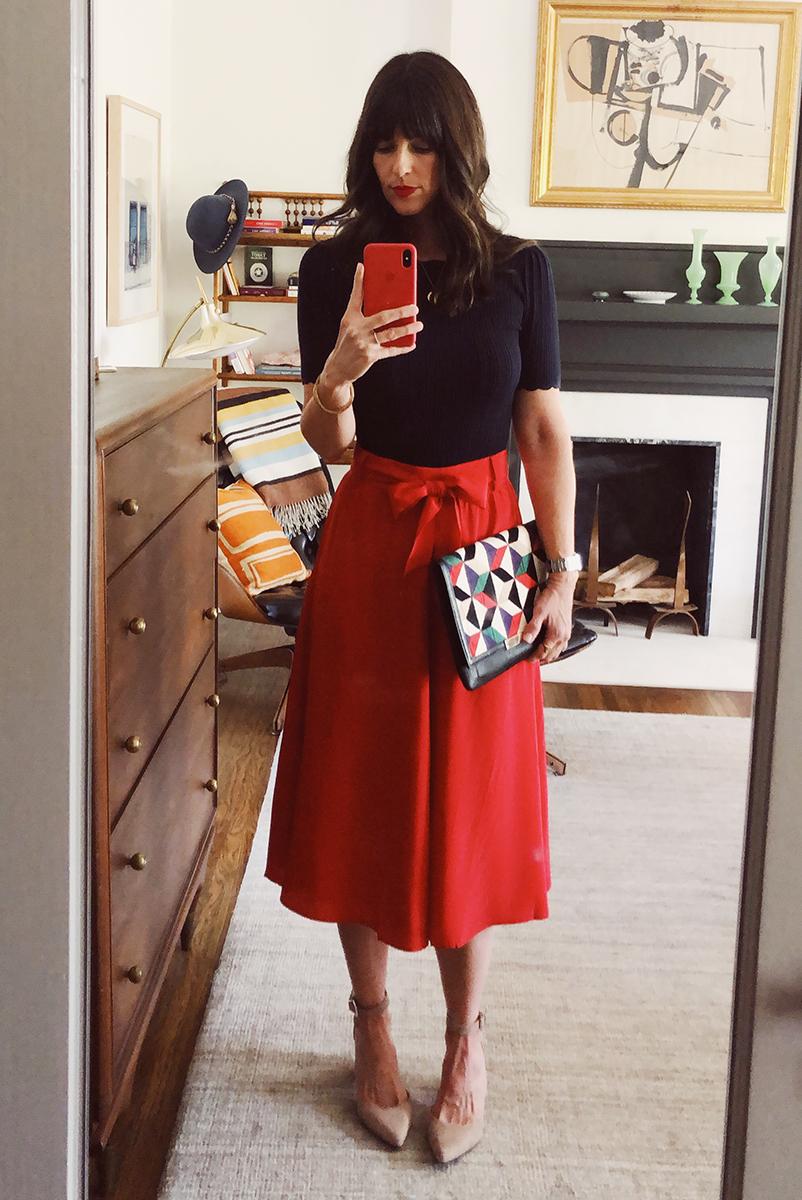 Sarah: Sezane Knit Top. Sezane Skirt. Lizzie Fortunato Clutch. Schutz Heels.
