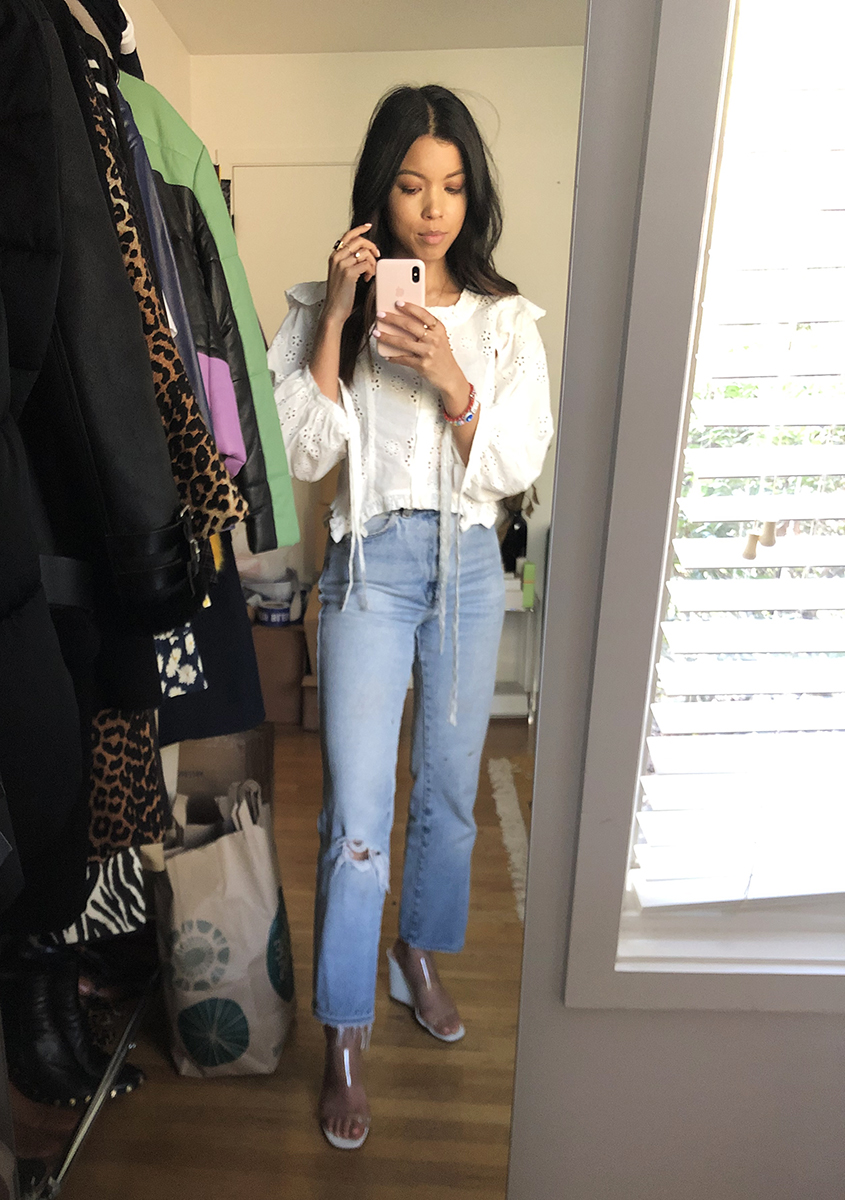 Tiana: Sandy Liang Top. Vintage Levi's Jeans. Maryam Nassir Zadeh Shoes.