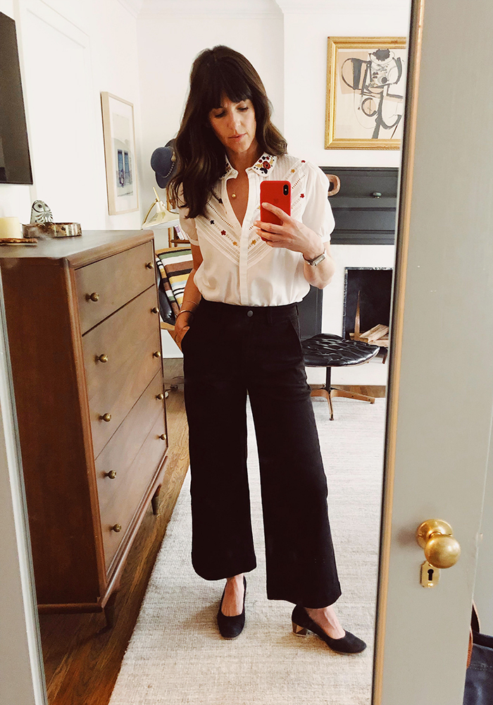 Sarah: Sezane Blouse. Everlane Trousers. Coclico Pumps. Cartier Watch. Vintage necklace.