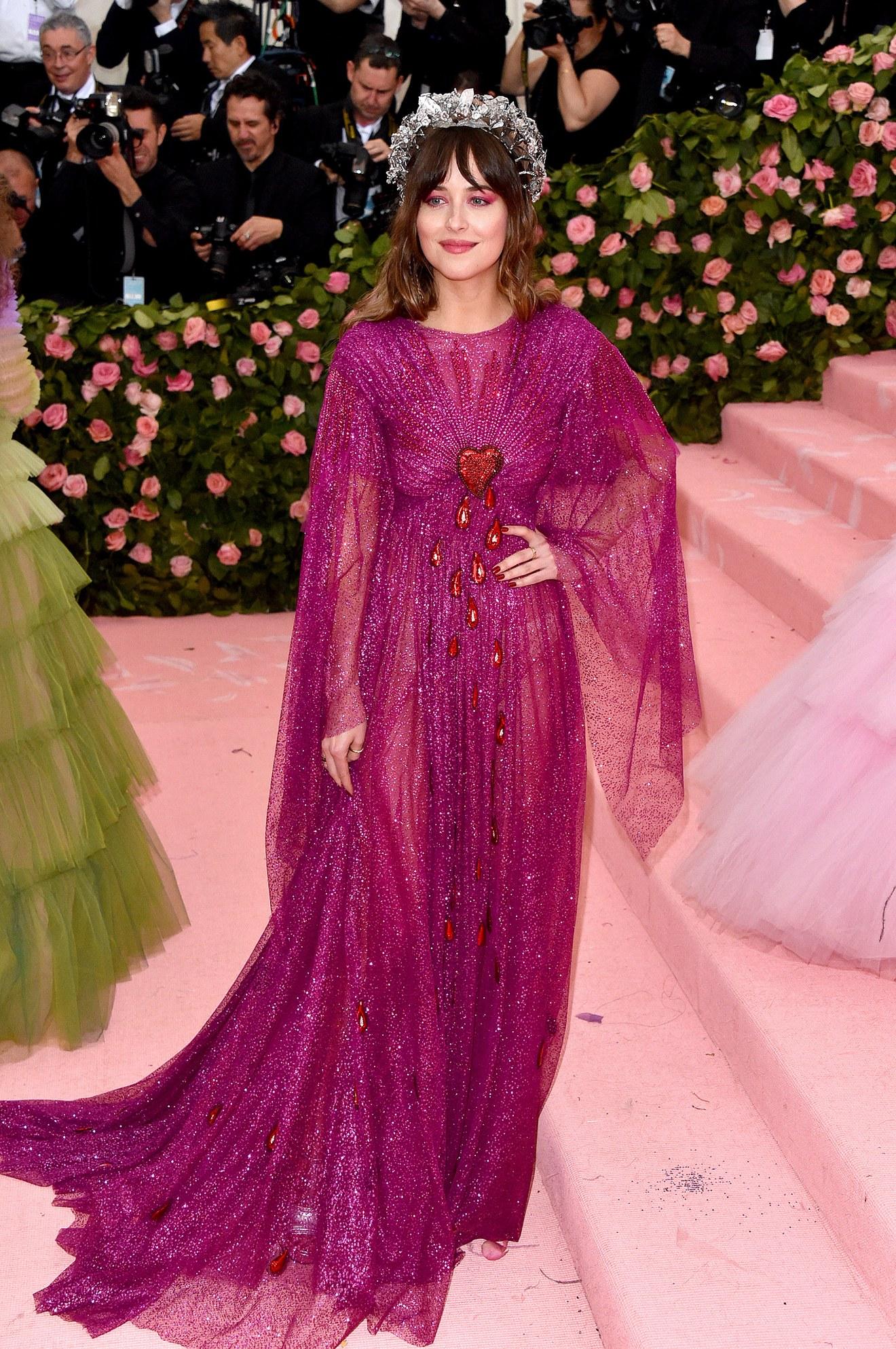 Dakota Johnson wearing Gucci / Getty.