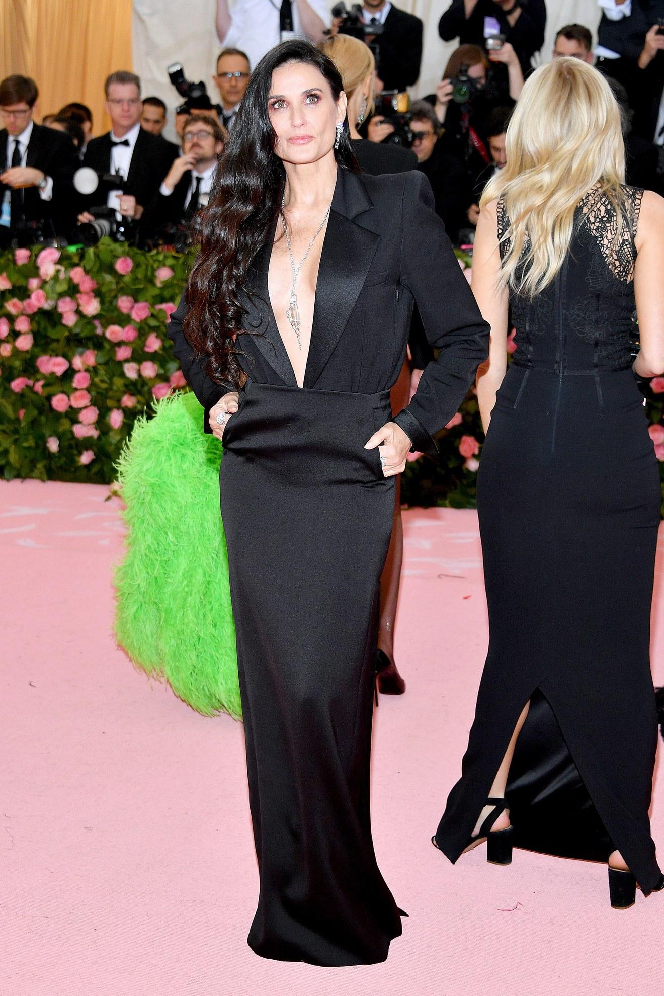 Demi Moore wearing Saint Laurent / Getty.