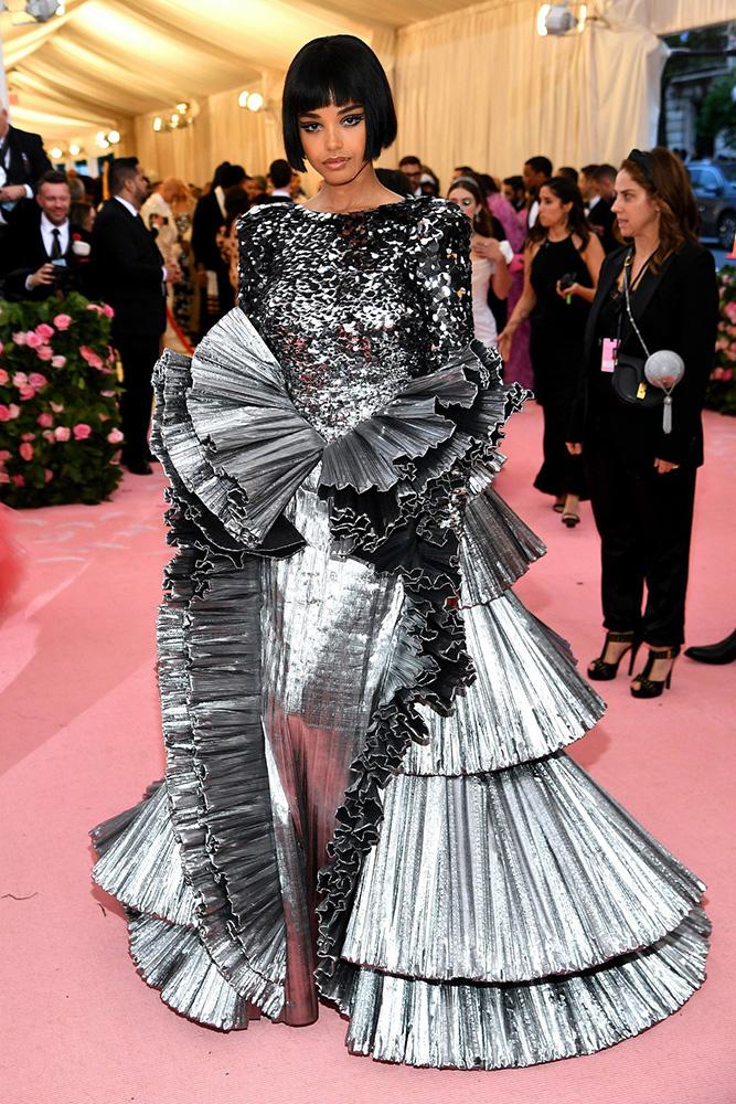 Ella Balinska wearing Tory Burch / Getty.