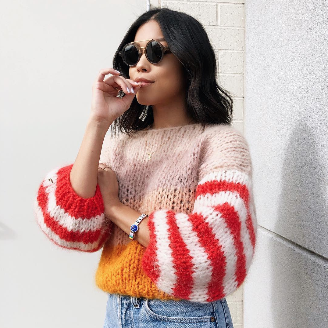 Sweater by Maiami, sunglasses by Celine, bracelet by Roxanne Assoulin.