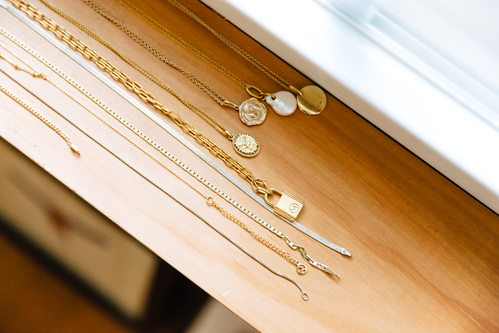 Necklaces on the window sill.