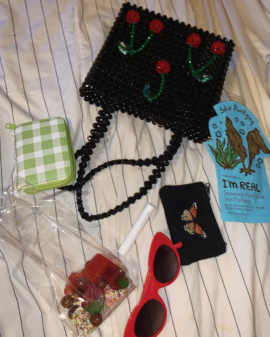 Urban Outfitters wallet, Susan Alexandra tote, Brandy Melville coin purse, Crap Eyewear sunglasses, and a Tony Moly mask.