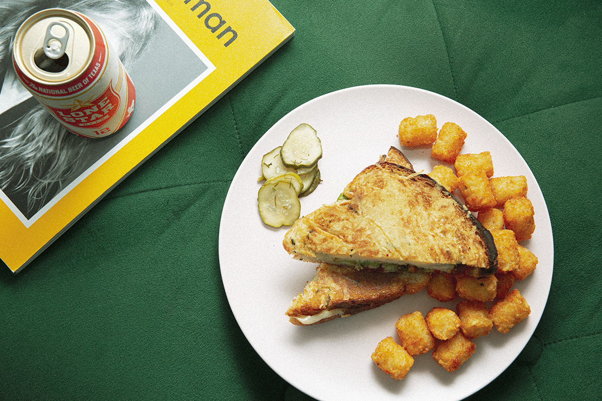 Turkey di Parma Grilled Cheese Sandwich with a side of Tots.
