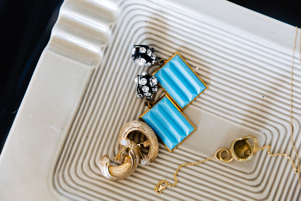 Gold earrings by Zara. Blue earrings by Marni.